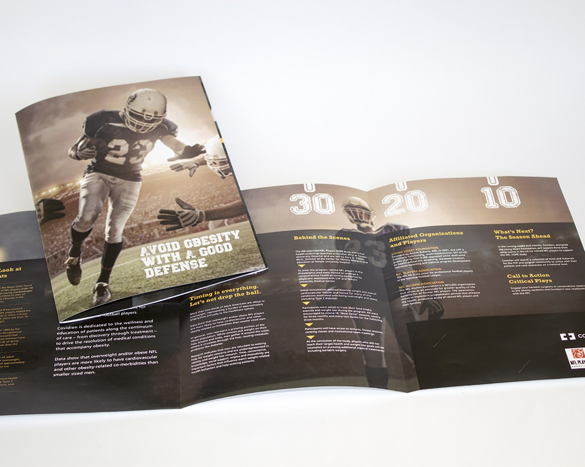 "We paired NFL marketing collateral such as action-oriented player photographs with the vital information and health tips, and the football theme was expanded to include a faux-pigskin covered ""Playbook"" containing additional information, brochures, and actionable lifestyle tips. Our brand strategy and comprehensive messaging also extended to other fun items for those who want to support the partnership, such as exclusive branded jerseys, footballs, and promotional materials to help create buzz around the obesity risk healthcare program."