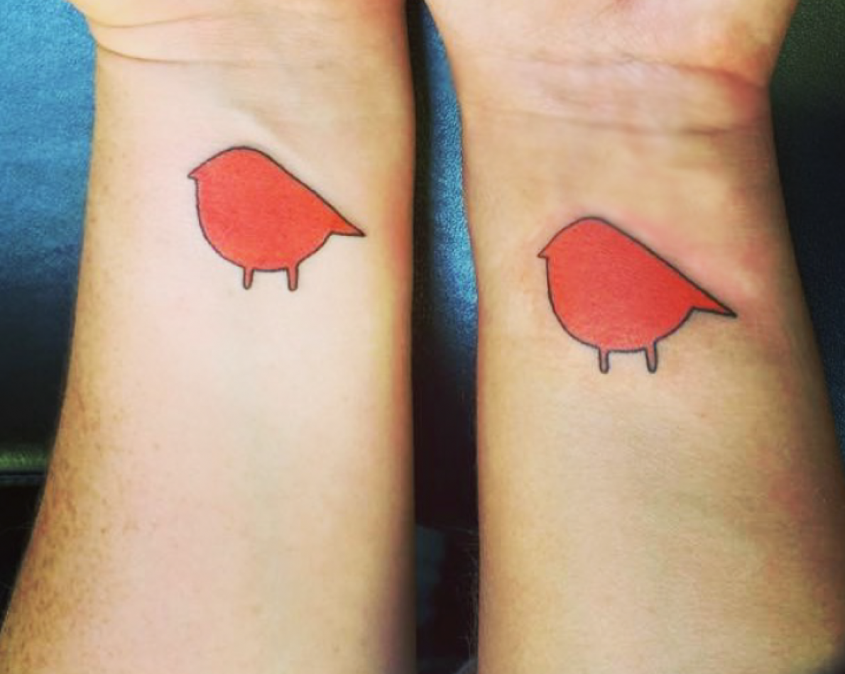 The owners were so pleased with the new logo, they had it tattooed on each of their wrists.