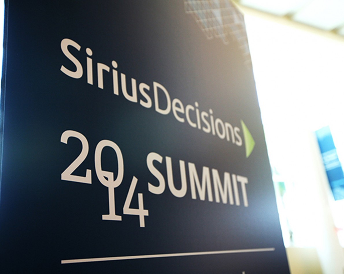 The green-arrow design of the new logo acts as effective directional signage at all SiriusDecisions events.
